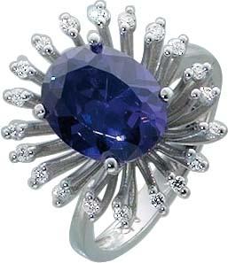 Designer-Ring. Ring aus echtem Silber Sterlingsilber 925/-, besetzt mit funkelndem lila Zirkonia (ca. 12 mm), dieser rundum gefasst mit 21 weißen funkelnden Zirkonia mit leicht nach unten verjüngenden Rinschiene im absoluten Topdesign. Ringkopfbreite ca.